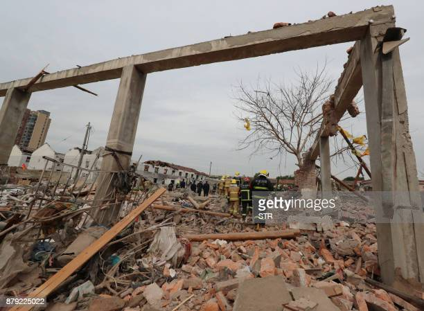 Rescue workers are seen at the site of an explosion in Ningbo China's eastern Zhejiang province on November 26 2017 A major explosion hit China's...