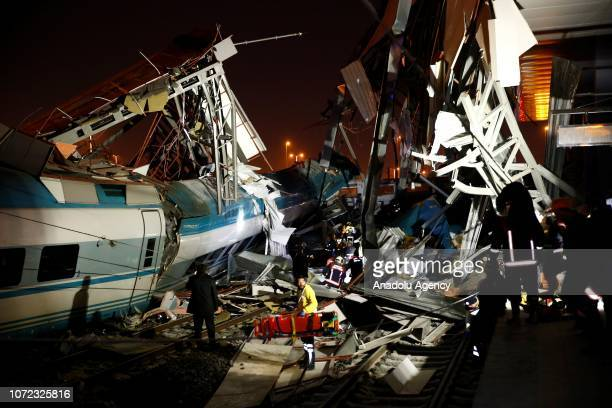 Rescue workers are seen at the station after highspeed train crashed in Turkish capital Ankara on December 13 2018