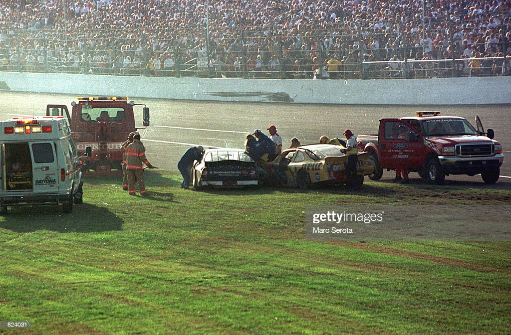 Rescue workers arrive at Dale Earnhardt's Goodwrench Chevrolet after a crash during the running of the 43rd Daytona 500 at the Daytona International Speedway February 18, 2001 in Daytona Beach, FL. NASCAR officials confirmed the 49-year-old, 78-time Winston Cup Champion driver, died in a crash on the final lap of the race.