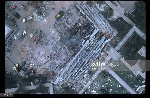 Rescue workers assemble near a collapsed building September 20 1985 in Mexico City Mexico An earthquake registering 81 on the Richter scale hit...