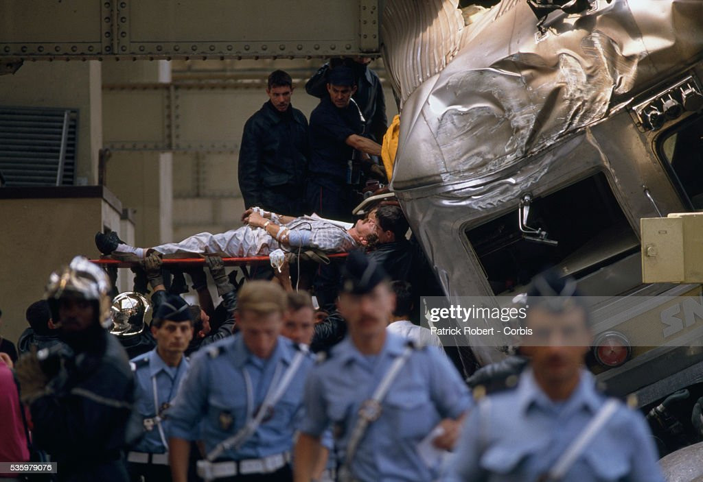 Rescue workers assist injured passengers after a train accident at the Gare de l'Est (East Station) in Paris. The passenger train crashed into a barrier in the station.