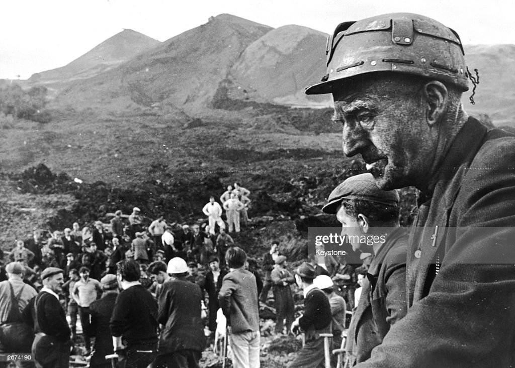 Rescue workers at the scene of the wrecked Pantglas Junior School at Aberfan, South Wales, where a coal tip collapsed killing over 190 children and their teachers.