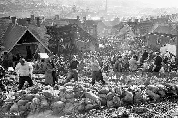 Rescue workers bagging and moving some of the coal spoil following the catastrophic collapse of a colliery spoil tip in the Welsh village of Aberfan...