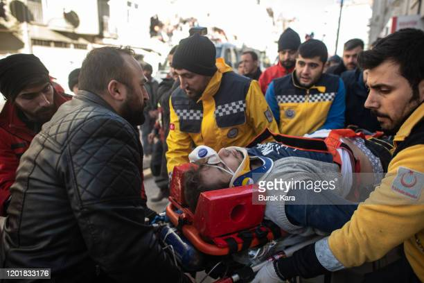 Rescue workers carry a survivor at the site of a collapsed building after 17 hours on from the earthquake on January 25 2020 in Elazig Turkey The...