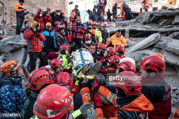 Rescue workers carry earthquake survivor Ayse Ylidiz from a collapsed building after surviving for 20 hours on January 25 2020 in Elazig Turkey The...