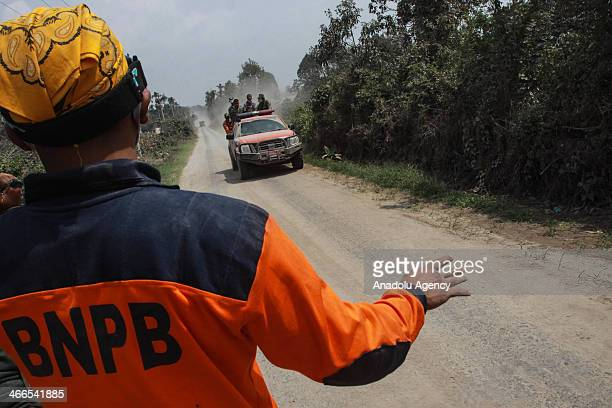 Rescue workers carry out the search and rescue activity at the volcano Sinabung eruption on the Indonesian island of Sumatra on January 2 2014 in...