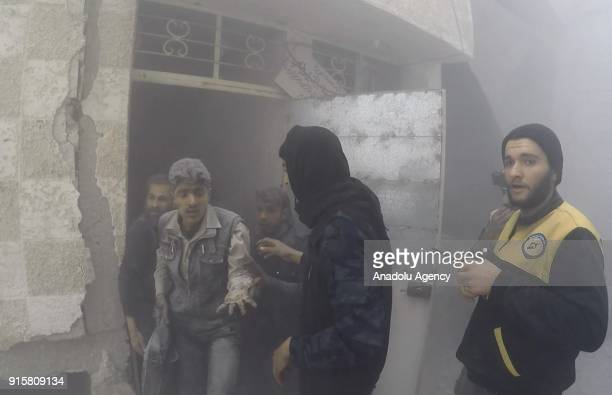 Rescue workers conduct search and rescue operations on debris of destroyed buildings after Assad Regime carried out land and airstrikes over Cisrin...