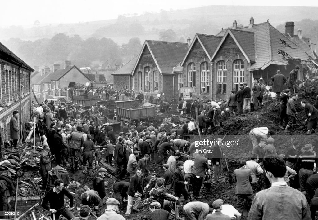 Rescue workers continue their search for victims of the Aberfan disaster, in South Wales, where 190 people lost their lives after part of the village school was engulfed by a giant coal slag heap.