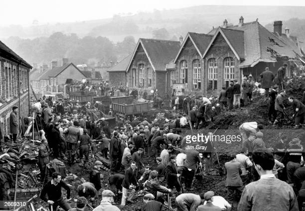 Rescue workers continue their search for victims of the Aberfan disaster in South Wales where 190 people lost their lives after part of the village...