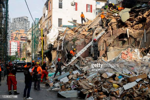Rescue workers dig through the rubble of a badly damaged building in Lebanon's capital Beirut in search of possible survivors from a megablast at the...