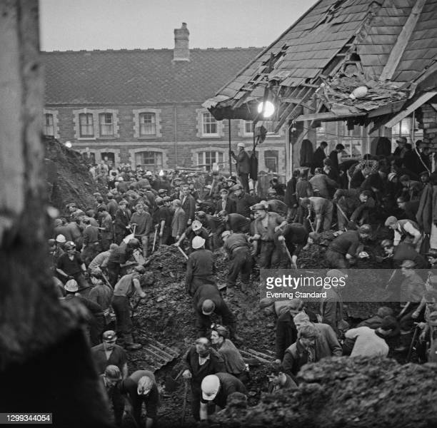 Rescue workers digging at the local primary school after the disaster in the coal mining village of Aberfan in Wales, UK, 22nd October 1966. The...