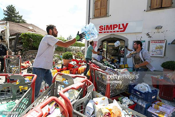 Rescue workers distribute emergency supplies from a supermarket following an earthquake in Amatrice Italy on Wednesday Aug 24 2016 A powerful...