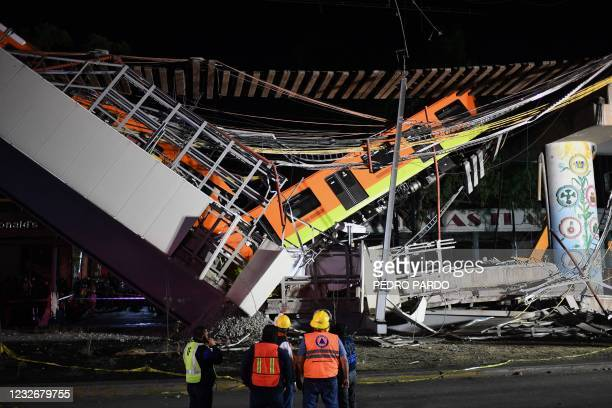 Rescue workers gather at the site of a train accident after an elevated metro line collapsed in Mexico City on May 4, 2021.
