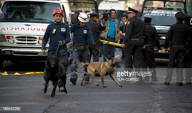 Rescue workers head for the skyscraper that houses the headquarters of stateowned Mexican oil giant Pemex in Mexico City on January 31 following a...