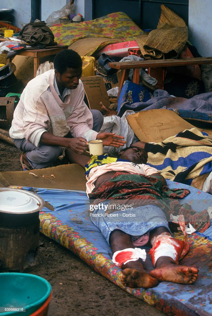 Rescue workers help the wounded after the Amahoro Stadium was bombed by the army during the civil war in Rwanda.