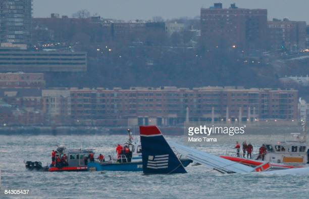 Rescue workers in boats assist a US Airways plane floating in the water after crashing into the Hudson River in the afternoon on January 15, 2009 in...