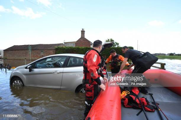 Rescue workers in Wainfleet All Saints, in Lincolnshire, where streets and properties are flooded after the town had more than two months of rain in...