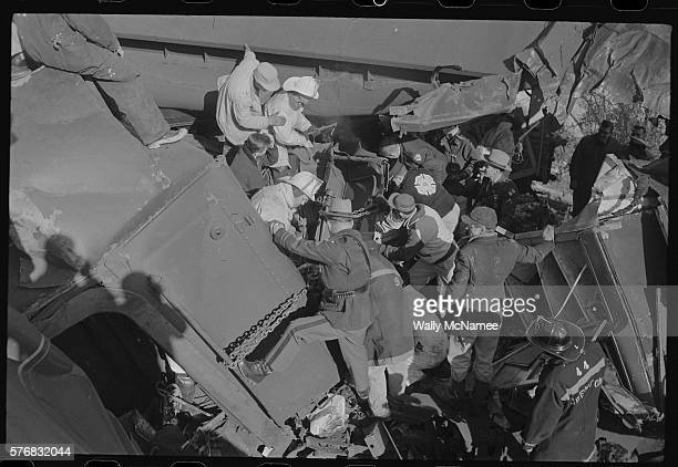Rescue workers including state police and firemen work to remove injured passengers from a train wreck near Odenton Maryland which is between...
