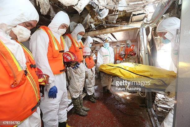 Rescue workers look for bodies of victims after a cruise liner sank in Yangtze River on June 6 2015 A total of 396 people have been confirmed dead...