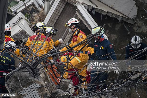 Rescue workers look for possible victims within the remains of an apartment in one of the top floors of the WeiKuan complex which collapsed in the...