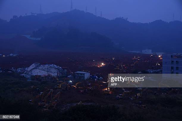 TOPSHOT Rescue workers look for survivors after a landslide hit an industrial park in Shenzhen south China's Guangdong province on December 21 2015...