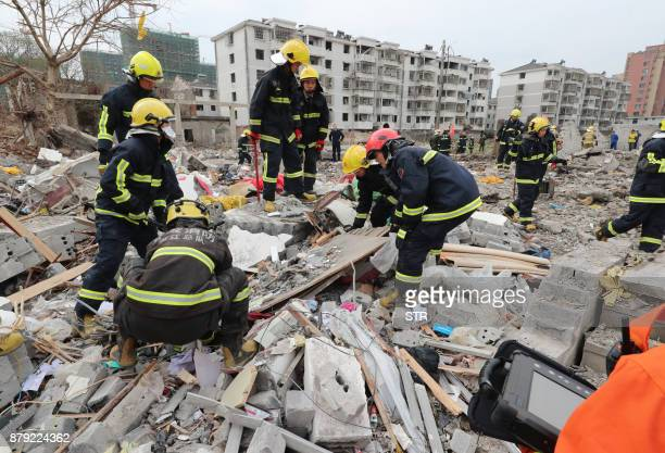 Rescue workers look for survivors after an explosion in Ningbo China's eastern Zhejiang province on November 26 2017 A major explosion hit China's...
