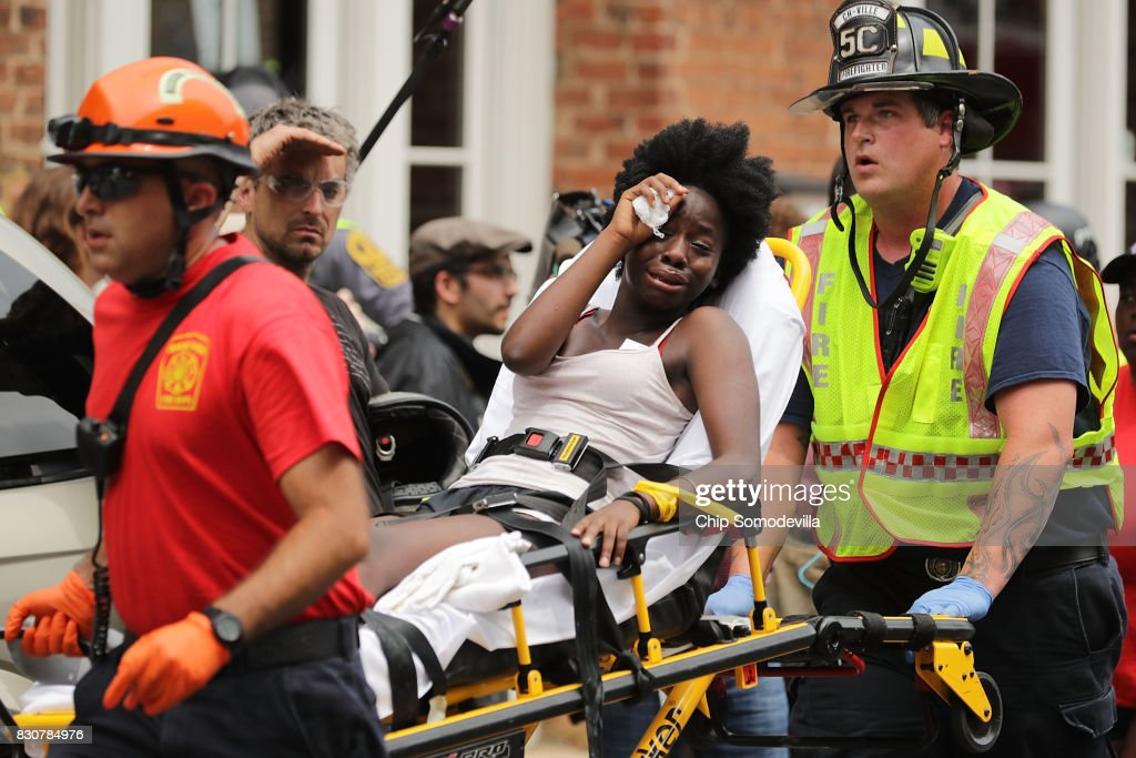 Rescue workers move victims on stretchers after car plowed through a crowd of counter-demonstrators marching through the downtown shopping district August 12, 2017 in Charlottesville, Virginia. The car plowed through the crowed following the shutdown of the 'Unite the Right' rally by police after white nationalists, neo-Nazis and members of the 'alt-right' and counter-protesters clashed near Emancipation Park, where a statue of Confederate General Robert E. Lee is slated to be removed.