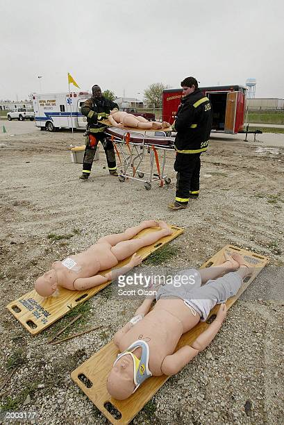 Rescue workers move victims to a triage area established at the site of a biohazard site during a largescale exercise testing the ability the US to...