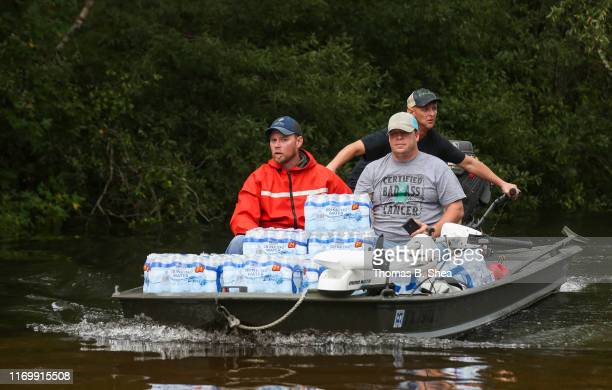 Rescue workers navigate flooded waters as they bring supplies to the First Baptist Church in Hamshire on highway 124 on September 20 2019 in Beaumont...