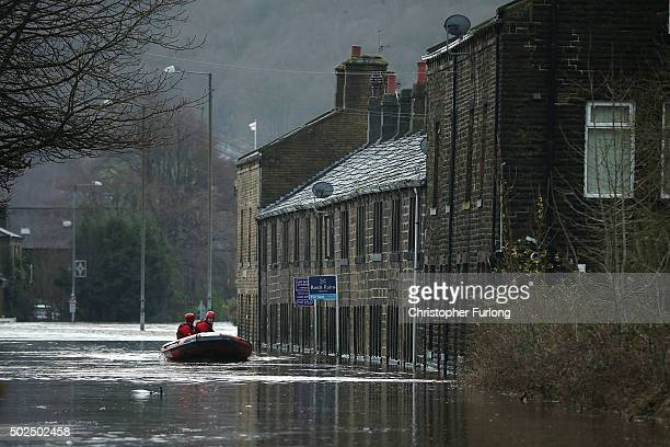 Rescue workers patrol the waters after the River Calder bursts its bank's on December 26 2015 in Mytholmroyd England There are more than 200 flood...