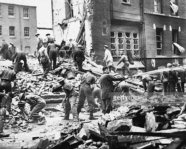 Rescue workers pick through the debris of a hospital bombed during a World War II air raid 1940
