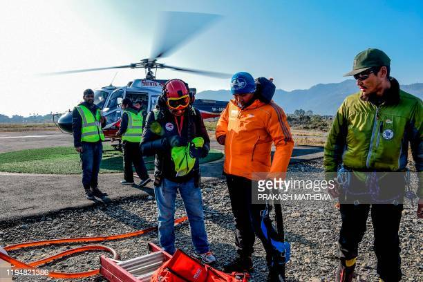 Rescue workers prepare to go on the avalanche site in Annapurna mountain region for searching the missing trekkers in Pokhara, some 200 kms west of...