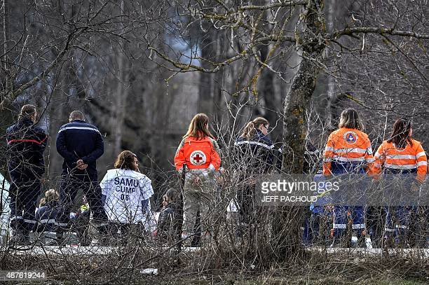 Rescue workers prepare to greet relatives of the Germanwings Airbus A320 crash victims upon their arrival in SeynelesAlpes on March 26 two days after...