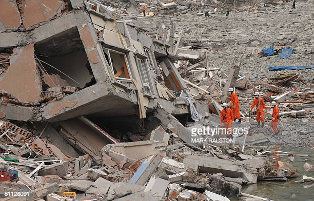 Rescue workers prepare to search a collapsed building at the earthquake damaged town of Beichuan in Sichuan Province on May 17 2008 Beichuan is one...