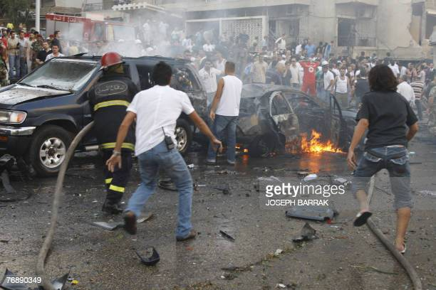 Rescue workers put out the blaze at the scene of a car bomb that ripped through a Christian suburb of Beirut and killed Lebanese deputy Antoine...