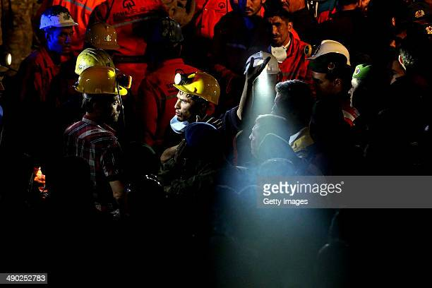 Rescue workers react on May 14, 2014 in Soma, Turkey. An explosion and fire in the coal mine killed at least 201 miners and trapped hundreds more....