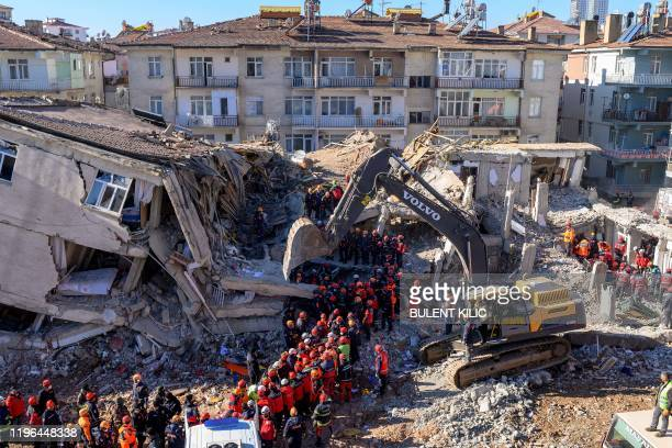 TOPSHOT Rescue workers remove corpses from the rubble of a building after an earthquake in Elazig eastern Turkey on January 26 2020 Rescue workers...