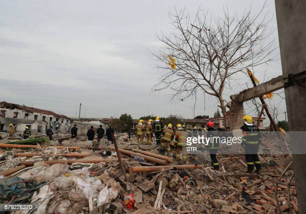 Rescue workers search at the site of an explosion in Ningbo China's eastern Zhejiang province on November 26 2017 A major explosion hit China's...