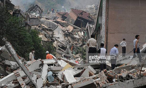Rescue workers search buildings for survivors at the earthquake damaged town of Beichuan in Sichuan Province on May 16 2008 Beichuan is one of the...