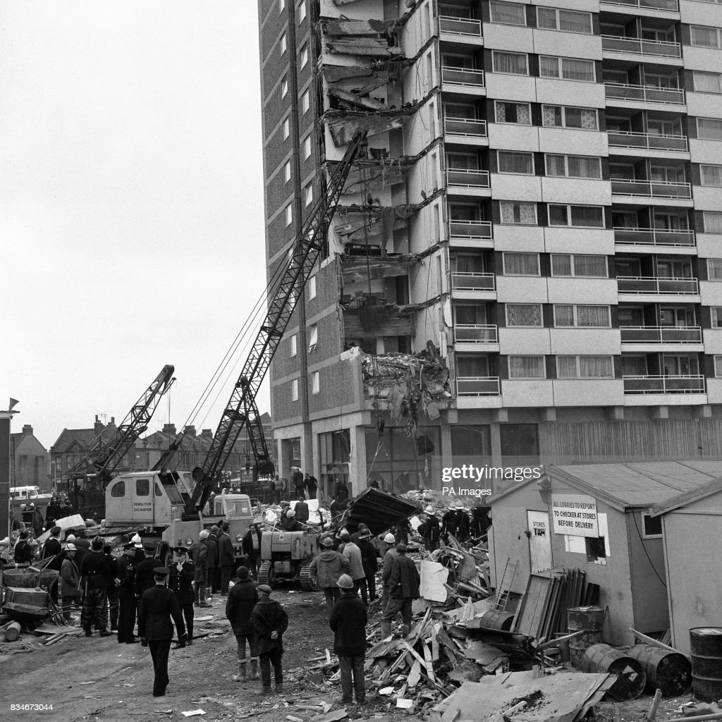 Rescue workers search debris after the collapse of a complete corner of Ronan Point, a 22 storey block of flats at Canning Town in the east End of London.