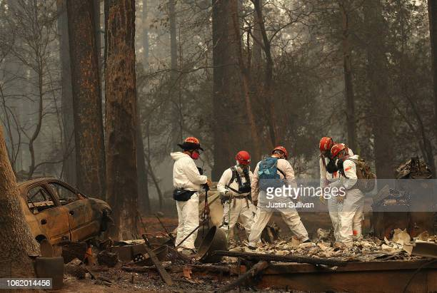 Rescue workers search for human remains at a home that was burned by the Camp Fire on November 15 2018 in Paradise California Fueled by high winds...