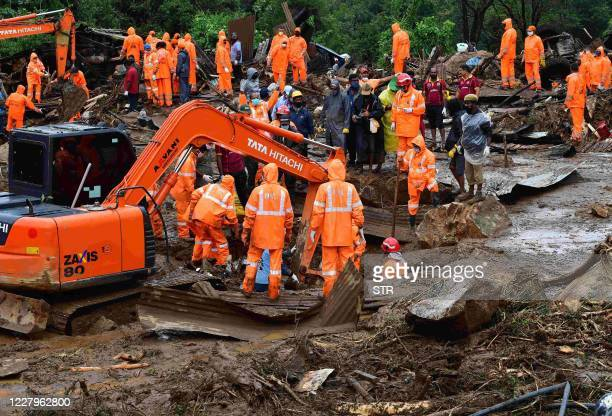 TOPSHOT Rescue workers search for missing people at a landslide site caused by heavy rains in Pettimudy in Kerala state on August 8 2020