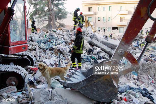 Rescue workers search for people trapped in the rubble of buildings damaged by yesterday's earthquake on April 7, 2009 in L'Aquila, Italy. The 6.3...