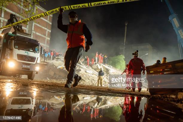 Rescue workers search for survivors in the debris of a collapsed building on November 1, 2020 in the Bayrakli district of Izmir, after a powerful...