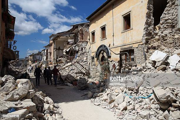 Rescue workers search for survivors in the rubble following an earthquake in Amatrice Italy on Wednesday Aug 24 2016 A powerful earthquake hit...