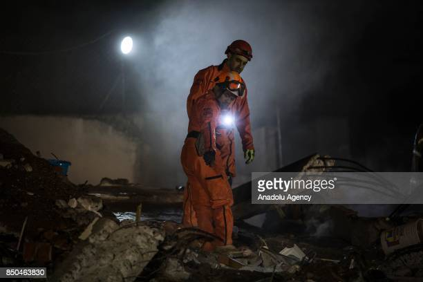 Rescue workers search for the trapped citizens over the collapsed buildings after a powerful magnitude 71 earthquake that hit Mexico City Mexico on...