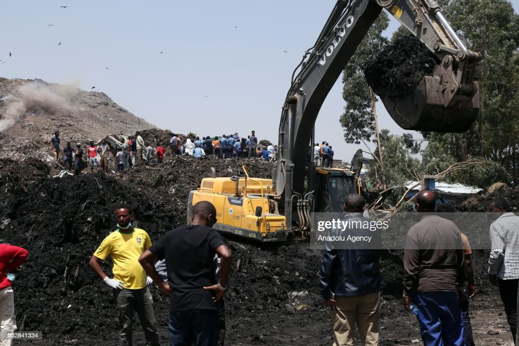 Rescue workers search for those buried by a landslide that swept through a massive garbage dump, killing at least 46 people and leaving several missing at Koshe rubbish tip in Kolfe Keranio district of Addis Ababa, Ethiopia on March 13, 2017. Rescue team continue to search missing people since yesterday.