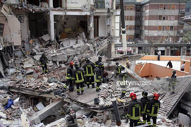 Rescue workers search for trapped people on a damaged building after an earthquake on April 6, 2009 in L'Aquila, Italy. The 6.3 magnitude earthquake...