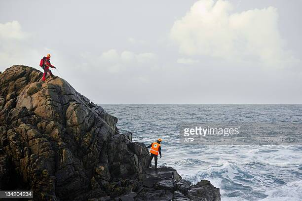 Rescue workers search for two men that were taken by a wave during the Berit storm outside of Egersund on November 28 2011 Norwegian rescuers were...