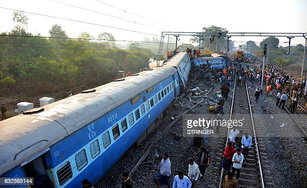 Rescue workers search for victims at the site of the derailment of the JagdalpurBhubaneswar express train near Kuneru station in southern Andhra...